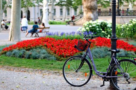 Zagreb, Croatia - June 15, 2019: Bike parked in beautiful Zrinjevac park in central Zagreb, Croatia. Selective focus.