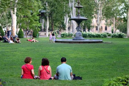 Zagreb, Croatia - June 15, 2019: People enjoying summer afternoon in beautiful Zrinjevac park in central Zagreb, Croatia. Selective focus.