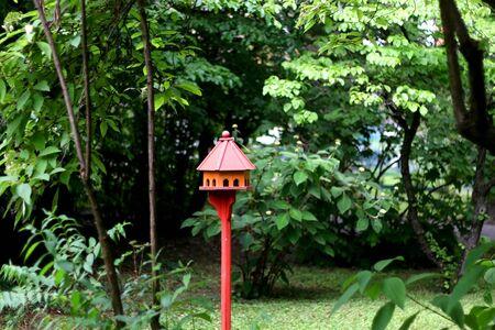 Cute red birdhouse in a botanical garden in Zagreb, Croatia. Selective focus. 스톡 콘텐츠