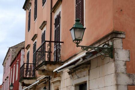 Retro lamp on a traditional colorful Mediterranean building in Stari Grad, on island Hvar, Croatia. Stock fotó