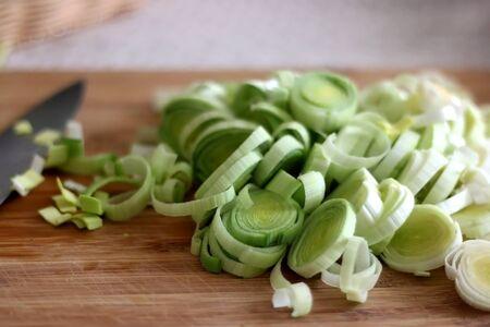 Chopped leek on a cutting board. Selective focus.