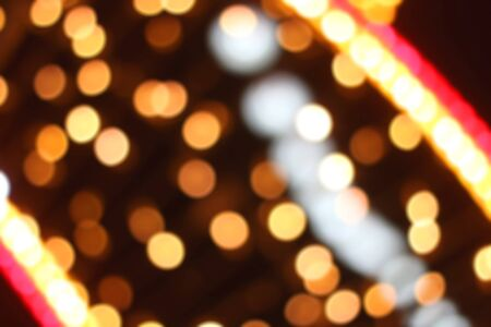 Defocused Christmas background with colorful bokeh lights.