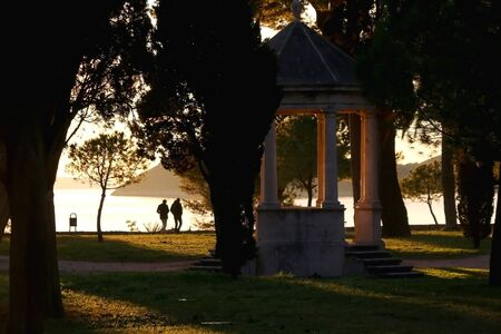 Historic gazebo in Sustipan park in Split, Croatia during sunset.