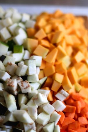 Chopped vegeatbles: eggplant, zucchini, butternut squash and red pepper. Selective focus.