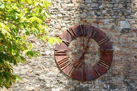 Historic clock, landmark on Kaptol, uptown Zagreb, Croatia. Selective focus. 免版税图像