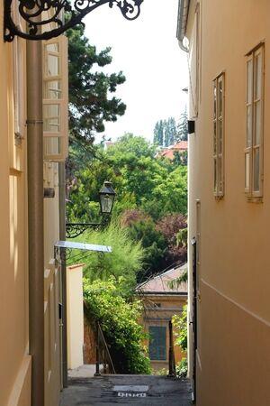 Vintage lamp in narrow alley in uptown Zagreb, Croatia. 免版税图像