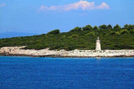 Small lighthouse on an island in southern Dalmatia, Croatia on a beautiful sunny day. 스톡 콘텐츠
