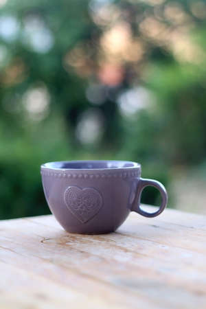 Cup of tea or coffee, served in a garden. Selective focus. 版權商用圖片