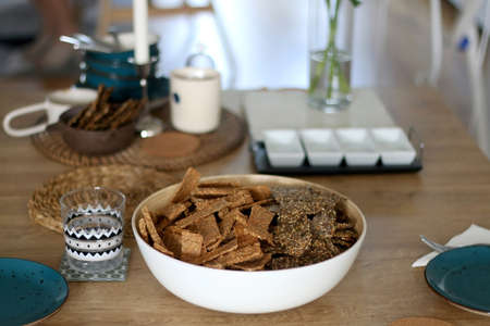 Two types of seed crackers, served in a big bowl on a table. Selective focus. Archivio Fotografico