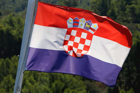 Flag of Croatia blowing in the wind. Forest in the background. Selective focus. Stock fotó - 157962009