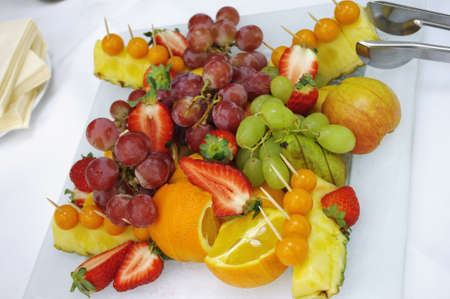 banket: dish of fruit at table with white tablecloth Stock Photo