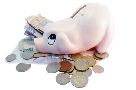 isolated Piggy bank money box with different currency money photo