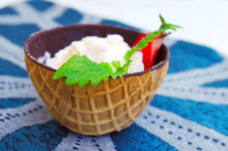 ice cream in chocolate waffle cones at blue napkin Stock Photo - 11304746