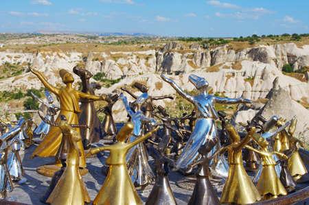 flute key: Figures of dance dervish over Cappadocia view