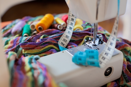 garment industry: Sewing tools and a colorful material
