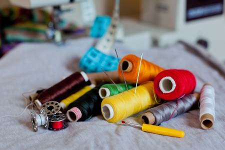 Sewing tools and a colorful material photo