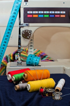 stitching machine: Sewing tools and a colorful material