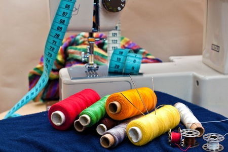 stitching: Sewing tools and a colorful material