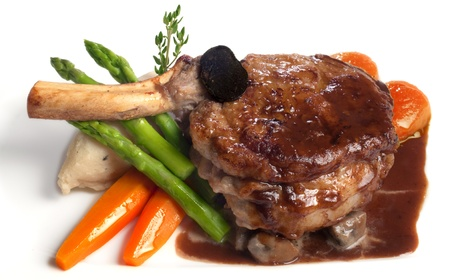 Veal chop served with vegetables