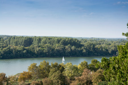 White river boat sailing the Danube under the clear blue sky, between Kalemegdan park and the woods of the Great War Island in Belgrade, Serbia Reklamní fotografie
