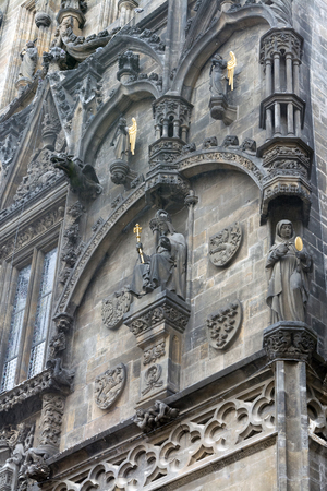 Sculptures at the front facade of the famous Powder tower in Prague, Czech Republic