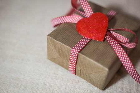 Gift box with red ribbon and hearts. Valentines day greeting card with place for text. Stock Photo
