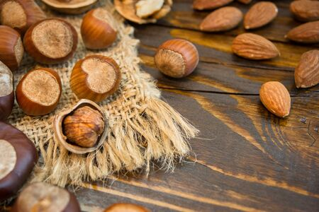 Mix of different nuts on a rustic background. Close-up photo with copy space. Healthy nutrition concept. Standard-Bild - 133179024