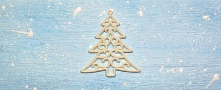 Christmas or winter composition. Pattern made of ornament in the shape of tree on textured light blue background. Christmas, winter, new year concept. Flat lay, top view, copy space. Stock Photo