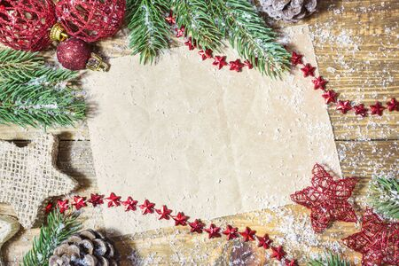 Blank paper with Christmas decoration, fir branches and snow on wooden background. Top view with copy space.