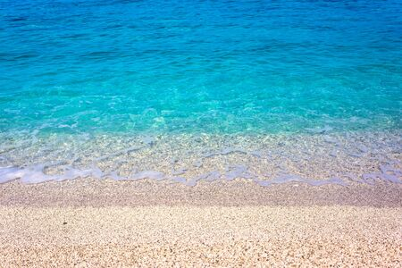 Close-up photo of beautiful beach with crystal clear turquoise water, west coast of Lefkada island, Greece. Stock Photo
