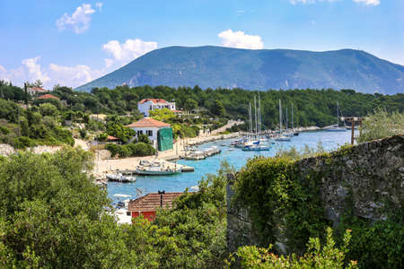 Beautiful seascape of Fiskardo bay. Fiskardo is a picturesque fishing village located on the northern most tip of Kefalonia island, Greece. Stock Photo