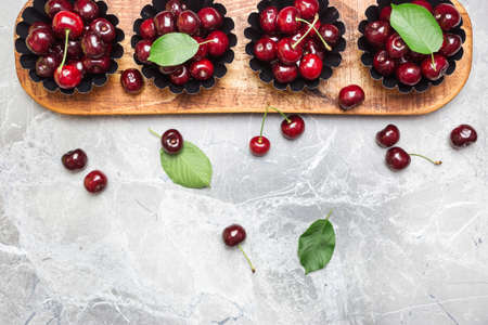 Flat lay composition with sweet cherries on marble table, space for text. Archivio Fotografico