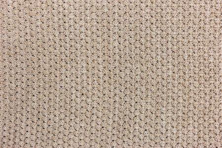 Beige knitting texture background, warm blanket. Good pattern for design.