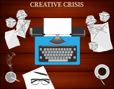 journalism: Creative crisis concept. Top view of writers workplace - typewriter, cup of coffee and cigarette. Wooden table background.