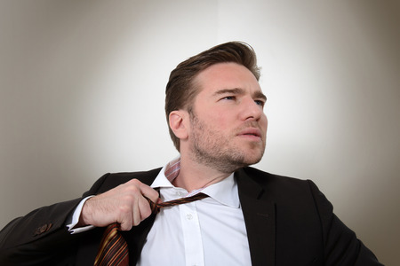 Young businessman loosening a tie  photo