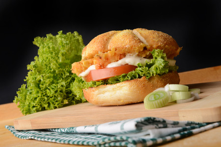 high calorie foods: Tasty fish burger with vegetables