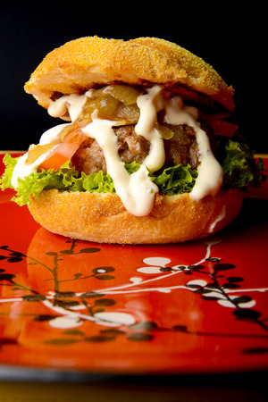 appetizing: Appetizing beef burger with onions