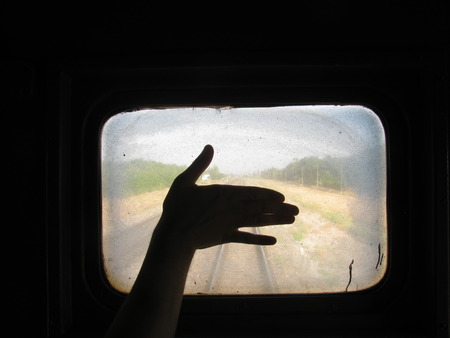 dirtiness: Silhouette Of Hand On A Background Of A Dirty Train Window