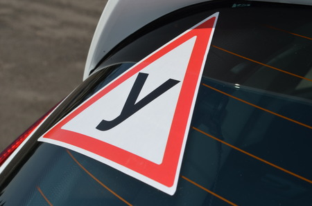 traffic warden: Sign Student on car windshield
