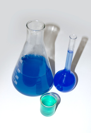 analytical chemistry: Test tube with blue liquid in the hand Stock Photo