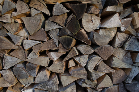 firewood background: stack of firewood background texture