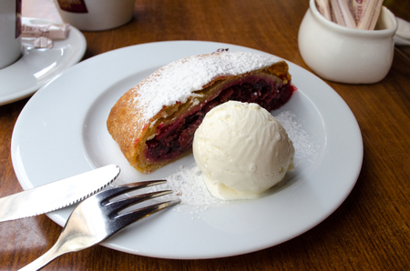 Cherry strudel and ice cream on a plate