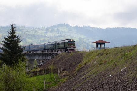 diesel train: diesel train traveling on the bridge over the mountain village