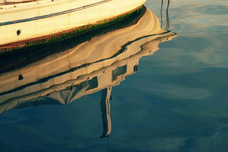 Boat reflection on sea surface. Stock Photo - 4604992