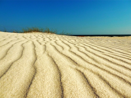 Ripples leading to the sand dune. Stock Photo