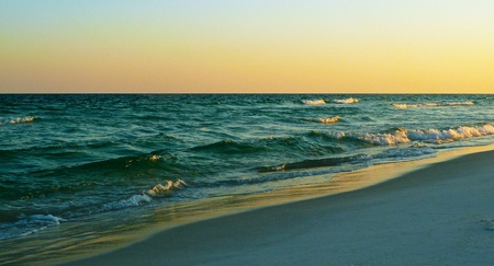 The shoreline at sunset. Stock Photo