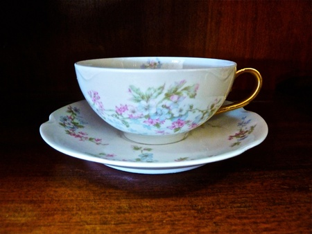 An antique teacup and saucer.