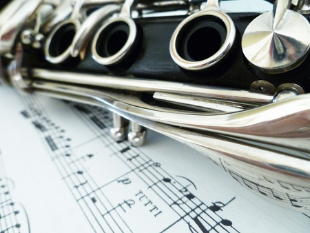 grenadilla: Sheet music with an interesting view of the clarinet. Stock Photo