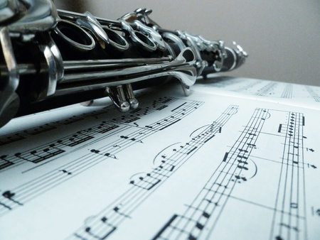 Sheet music with a lengthened view of the clarinet.