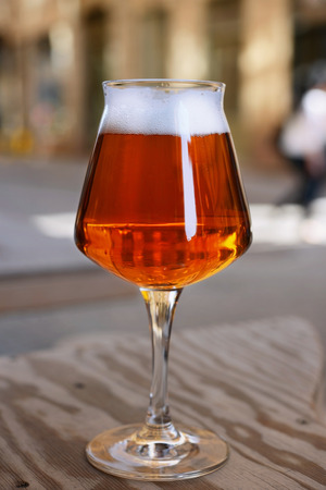 ipa: Glass of IPA beer on wooden table